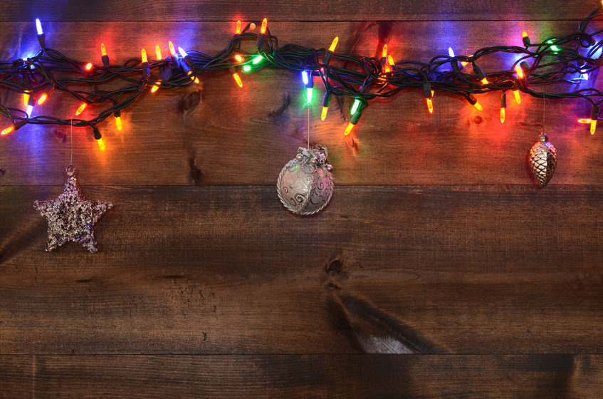33935183 - three silver ornaments and christmas lights